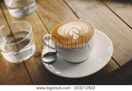 Closeup of  professional barista made coffee with froth art