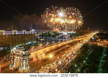 Arch of Triumph, fireworks and Poklonnaya Hill Memorial at night in Moscow, Russia