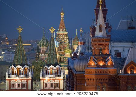 Close up view of part of St. Basil cathedral and historical museum on Red Square at night in Moscow