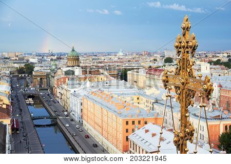 Closeup cross of Church of Our Saviour on Spilled Blood or Resurrection of Christ Spas-na-krovi in Saint-Petersburg against cityscape.