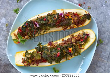Two stuffed zucchini with meat and chard.