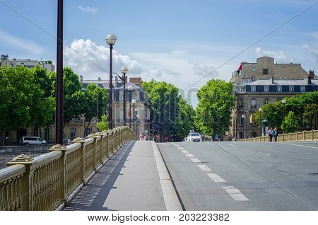 Paris, France - June 4, 2017: Boulevard de la Tour-Maubourg is shot from Invalides bridge. Left sidewalk leads to AMF building. Embassy of the UAE is located in right side