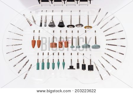 Set of different grinding and cutting accessories for mini drill machine in the box