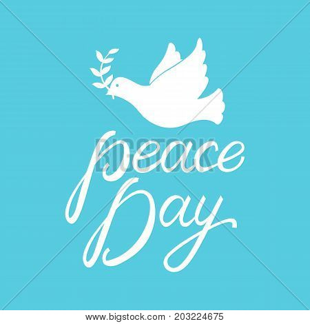 Peace dove with olive branch for International Peace Day poster. Inscription brush Day Peace on blue background