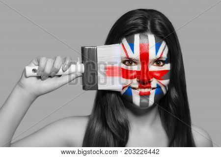 Female supporter in national colors of Great Britain