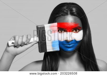 Female supporter in national colors of the Netherlands