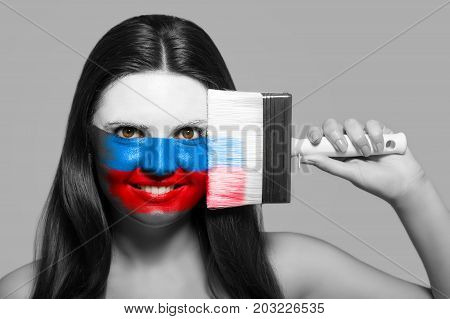 Female supporter in national colors of Russia