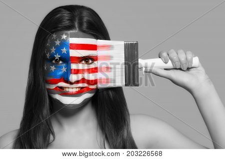 Female supporter in national colors of the United States of America