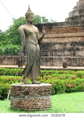 This is an androgyynous Buddhist Arhat an enlightened helper of the Buddha in the ruins of Sukhothai Thailand. poster