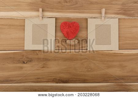 picture frame paper and red heart pace on wood backgroundLove valentine vintage.