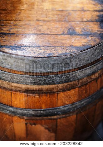 Old wooden Barrel close up. Natural grunge textured barrel. Dark surface with old natural wooden pattern. Vintage concept