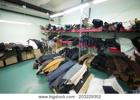 MOSCOW - FEB 21, 2017: Workshop with shelves with leather rolls at Ralf Ringer shoes factory. Ralf Ringer has 41 brand store in Moscow