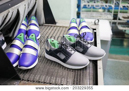 MOSCOW - FEB 21, 2017: Conveyor with new sneakers at Ralf Ringer shoes factory. The growth in gross revenue of Ralf Ringer in 2016 is 39 per cents