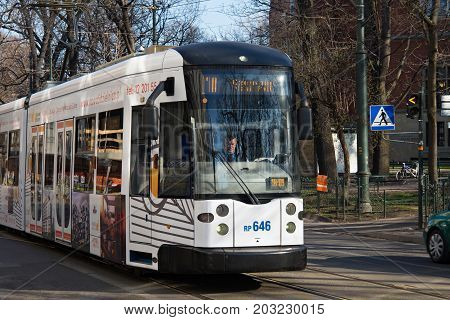 KRAKOW, POLAND - MARCH 28, 2017: Tram Bombardier NGT6 in the historic part of Krakow. Total in Krakow more than 90 kilometers of tram tracks and 24 routes.