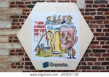 HOEGAARDEN, BELGIUM - SEPTEMBER 04, 2014: Big beermat Hugarden with an advertising illustration on a brick wall. The Hoegaarden brewery is a brewery in Hoegaarden and a producer of famous wheat beer.