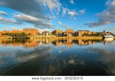 Summer Troy's Riverfront with blue sky and clouds