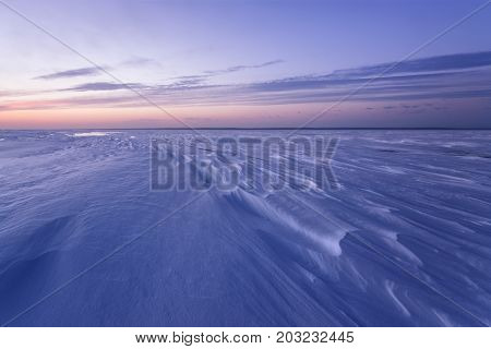 cold winter morning on the lake / the pattern of snow on the lake surface before dawn