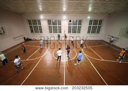 MOSCOW - FEB 9, 2017: People play volleyball in gym in Dobrynya boxing club