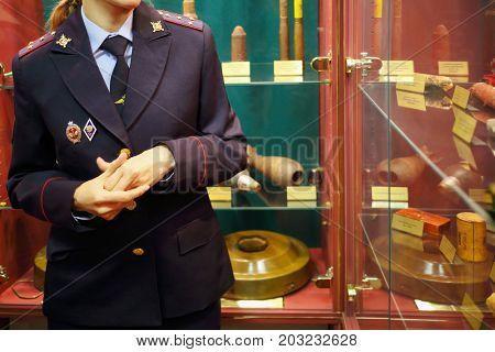 MOSCOW - SEP 22, 2016: Woman (noface) tours in museum of at Petrovka, 38, Main Department of Moscow Ministry of Internal Affairs