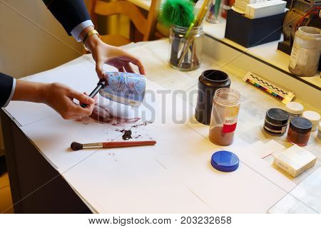 MOSCOW - SEP 22, 2016: Woman takes fingerprints from cup in Forensic Center at Petrovka, 38, Main Department of Moscow Ministry of Internal Affairs