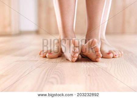 Foot gymnastics. Exercises of baby feet. Feet of mother and baby