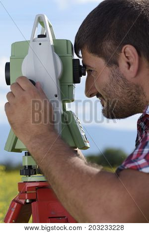 Total station Close-up Surveyor Rapeseed Looking Geodesy