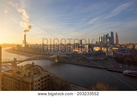 MOSCOW - DEC 11, 2015: Bridge of Bogdan Khmelnitsky, thermal power plant during evening