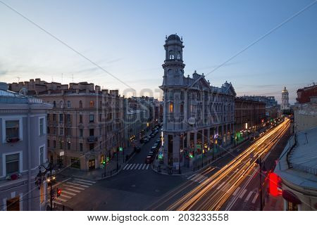 ST. PETERSBURG, RUSSIA - JUNE 21, 2015: Popular road crossing called Five Corners at evening. One of symbols of city is Apartment house with turret