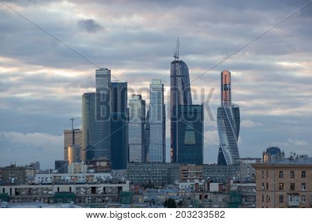 MOSCOW - JUL 12, 2015: Futuristic Moscow International Business Center at summer evening. East tower of complex Federation in height 374 m - highest skyscraper in Europe