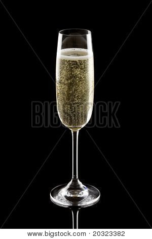 Glass of champagne isolated on a black background