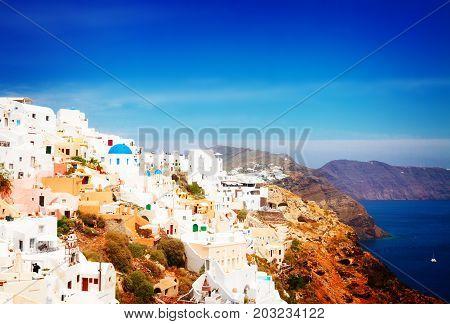 Oia, traditional greek white village townscape and caldera of volcano, Santorini, Greece