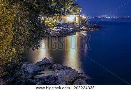 A night scenery of a bay in Opatija on Croatian coast