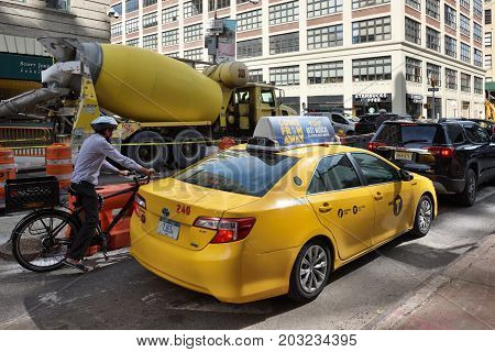 NEW YORK CITY USA - AUG. 23 : Yellow taxis on street in Manhattan on August 23 2017 in New York City NY. Manhattan is the most densely populated borough of New York City.