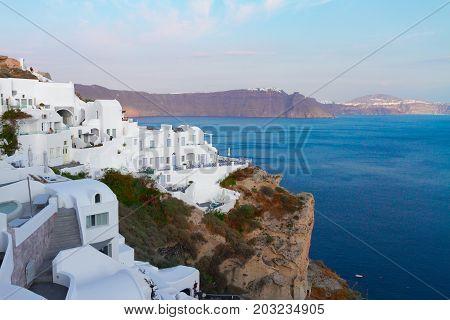 view of volcano caldera with white houses and deep blue water of Aegan sea, Santorini island, Greece
