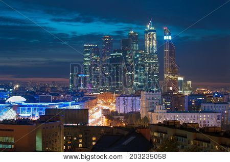 MOSCOW - JUN 15, 2015: Modern Moscow International Business Center with illumination. Investments in Moscow International Business Center was approximately 12 billion dollars