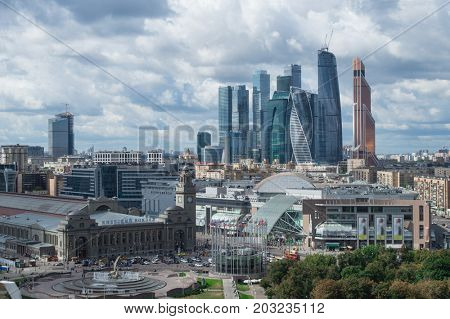 MOSCOW - AUG 30, 2015: Moscow International Business Center and Kievsky railway station. Investments in Moscow International Business Center was approximately 12 billion dollars