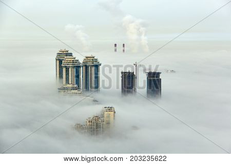 MOSCOW, RUSSIA - SEP 26, 2014: Residential complex Sparrow Hills (Vorobyovy Gory) and construction site of residential complex Dolina Setun in morning fog.