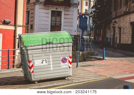 GETXO near BILBAO - July 19 2016 - in the street a typical public garbage container in spain