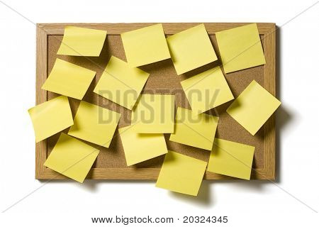 Yellow post it notes covering a cork board, isolated on a white background