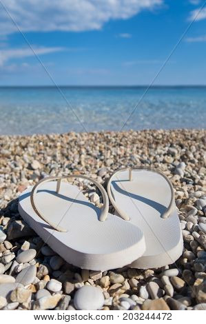 Close Up Of Sandals On Beautiful Greek Beach