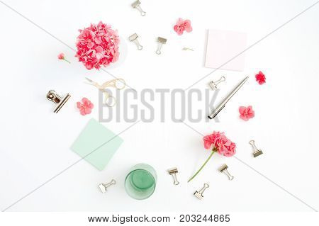 Flat lay fashion office desk with space for text. Female frame workspace with red flowers accessories mint diary on white background. Top view feminine background.