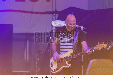 Minsk Belarus-August 12 2017: Bass Guitarist and Contrabass Player Makrus Bodenseh of World Renowned Jazz Ensemble De-Phazz Performing at A-Fest Music Festival on August 12 2017 in Minsk Republic of Belarus.