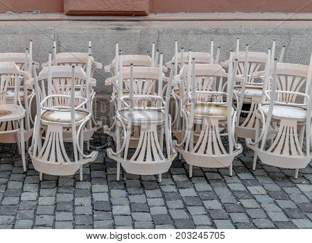Stack of white chair in the city