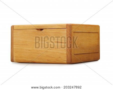Close-up of a light brown wooden box container isolated on a white background. A closed empty natural crate for storage. A rustic antique box for keeping small items. Cargo delivery and shipment.