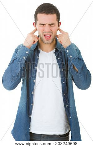 handsome young man covering his ears, isolated white background