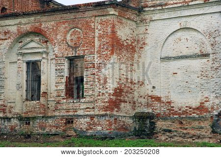brick wall of old ancient dilapidated abandoned orthodox chrurch