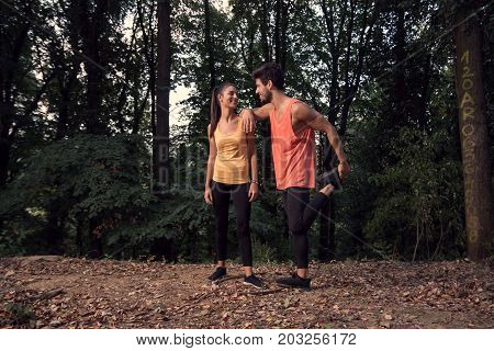 Man Woman, Friends, Two Young People Leisure, Outdoors Forest Nature Trees, Stetching Legs, Smiling