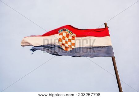 Croatian flag in the wind. Symbolic object.