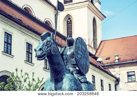 Equestrian statue of margrave Jobst of Luxembourg and Church of St. Thomas Brno Moravia Czech republic. Blue photo filter.