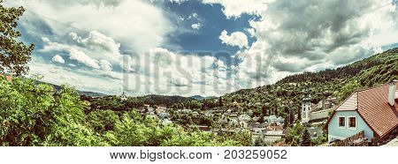 Panoramic photo of Banska Stiavnica with New castle and Old castle Slovak republic. Travel destination. Beautiful urban landscape. Beauty photo filter.